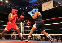 Claressa Shields (red) in one of the steps of her dance in the ring. Photo taken in Spokane, Washington February 2012